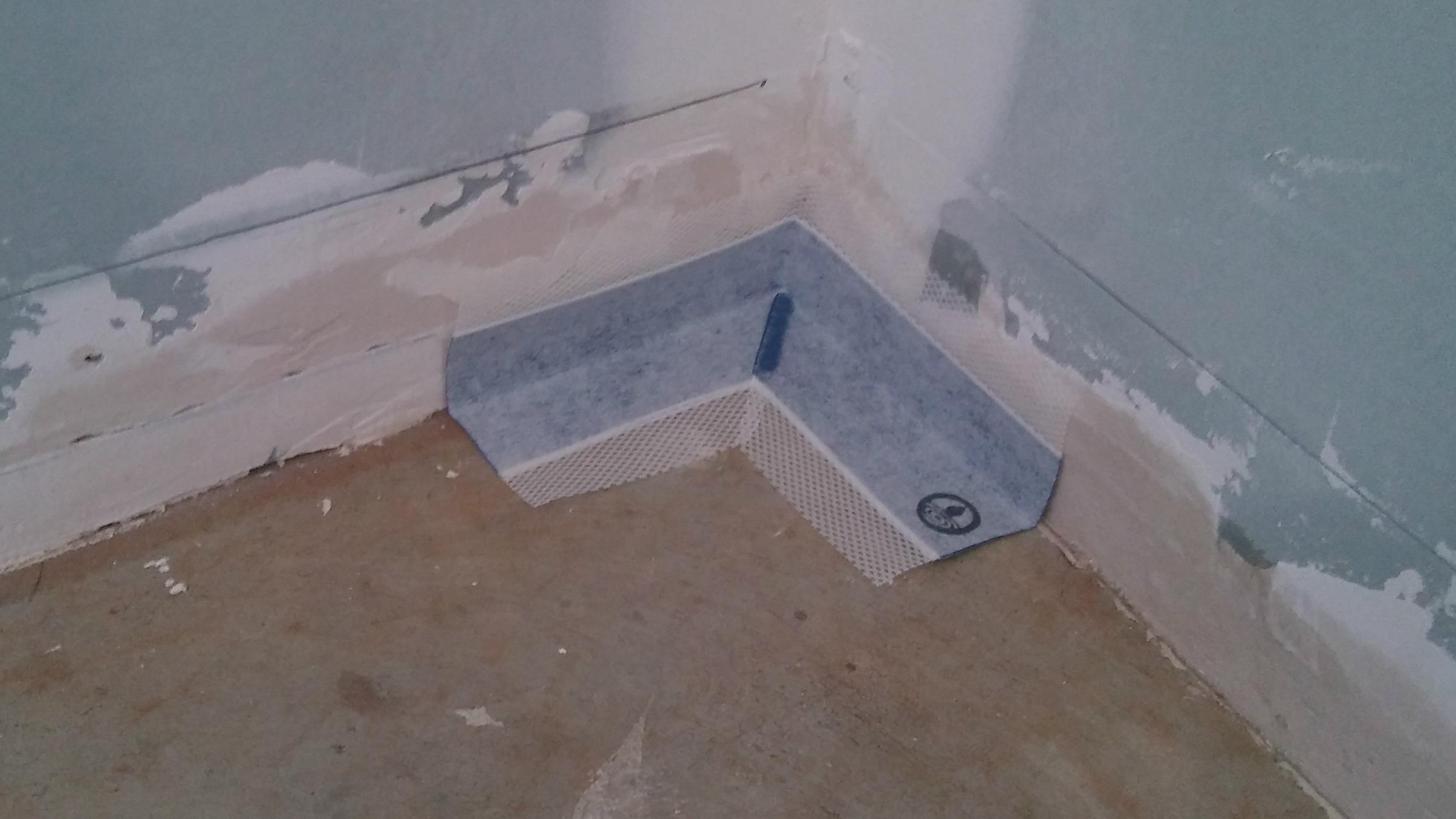 shower floor waterproofing corner pocket