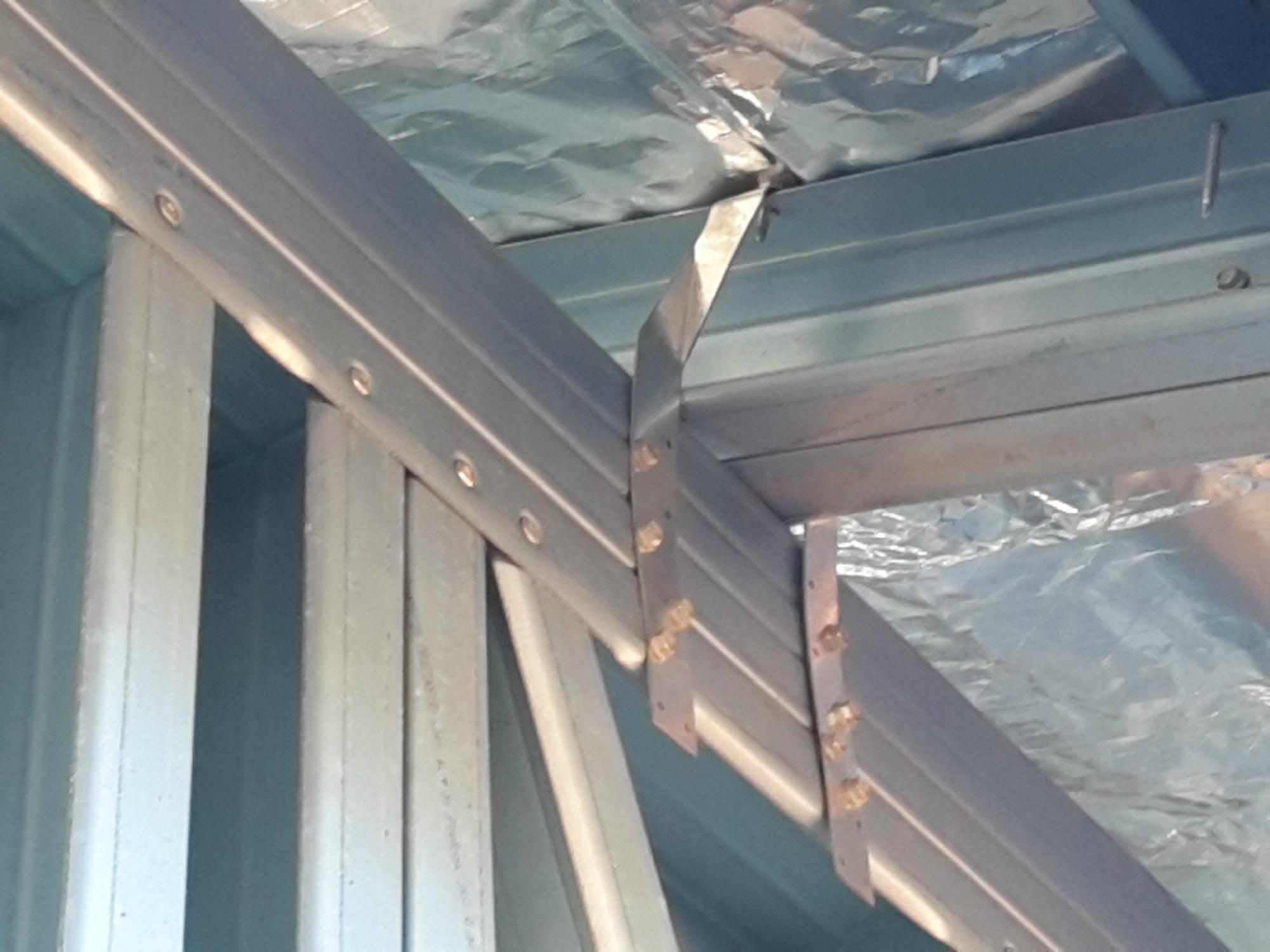 Steel frame roof tie down