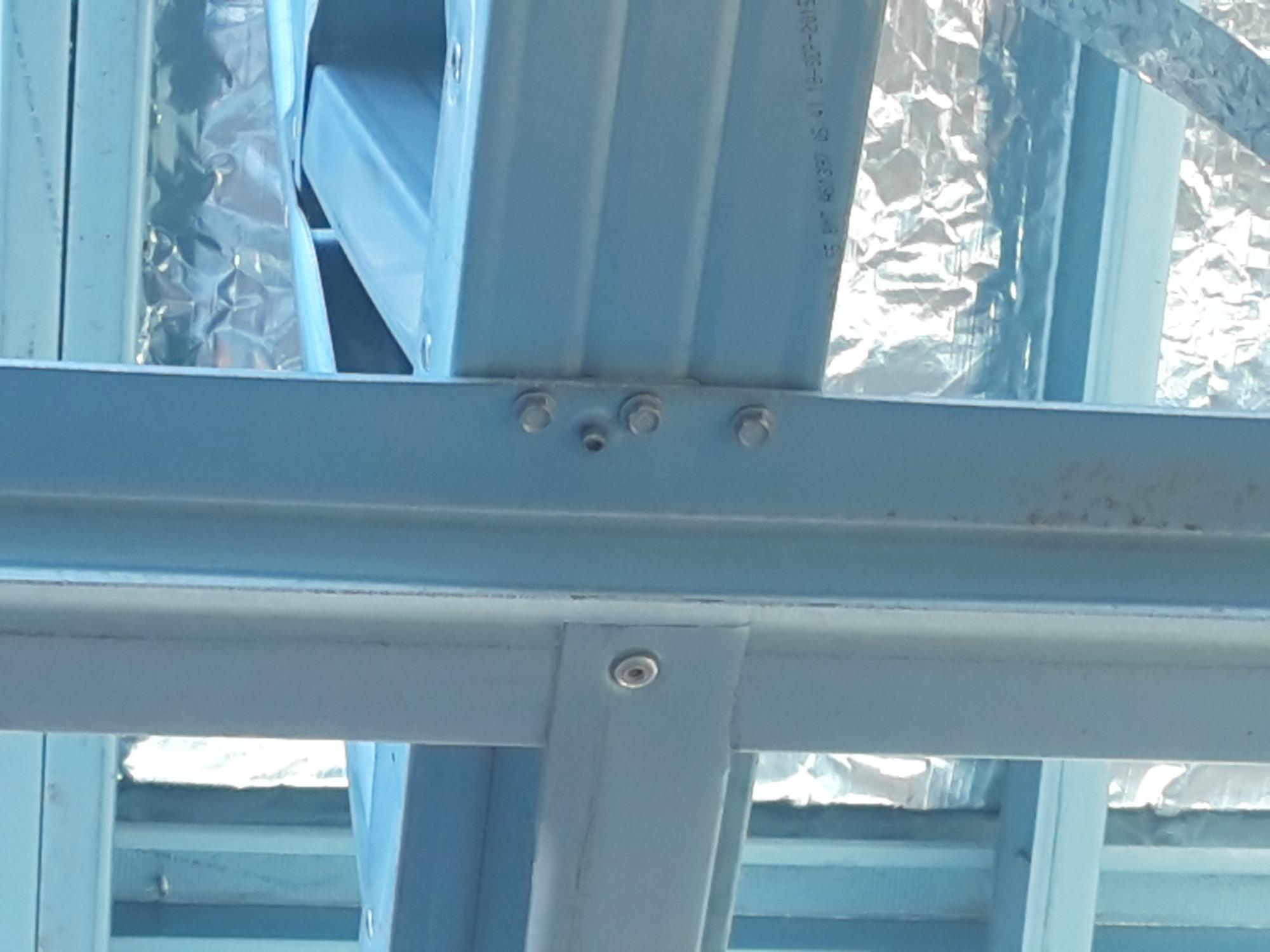 Steel ceiling tie down