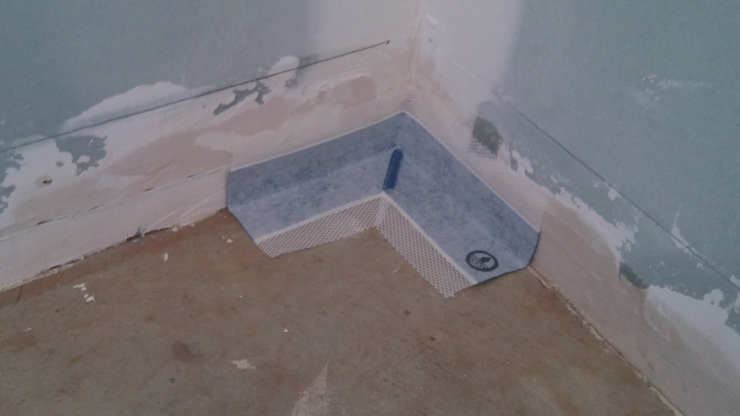 shower floor waterproofing corner pocket