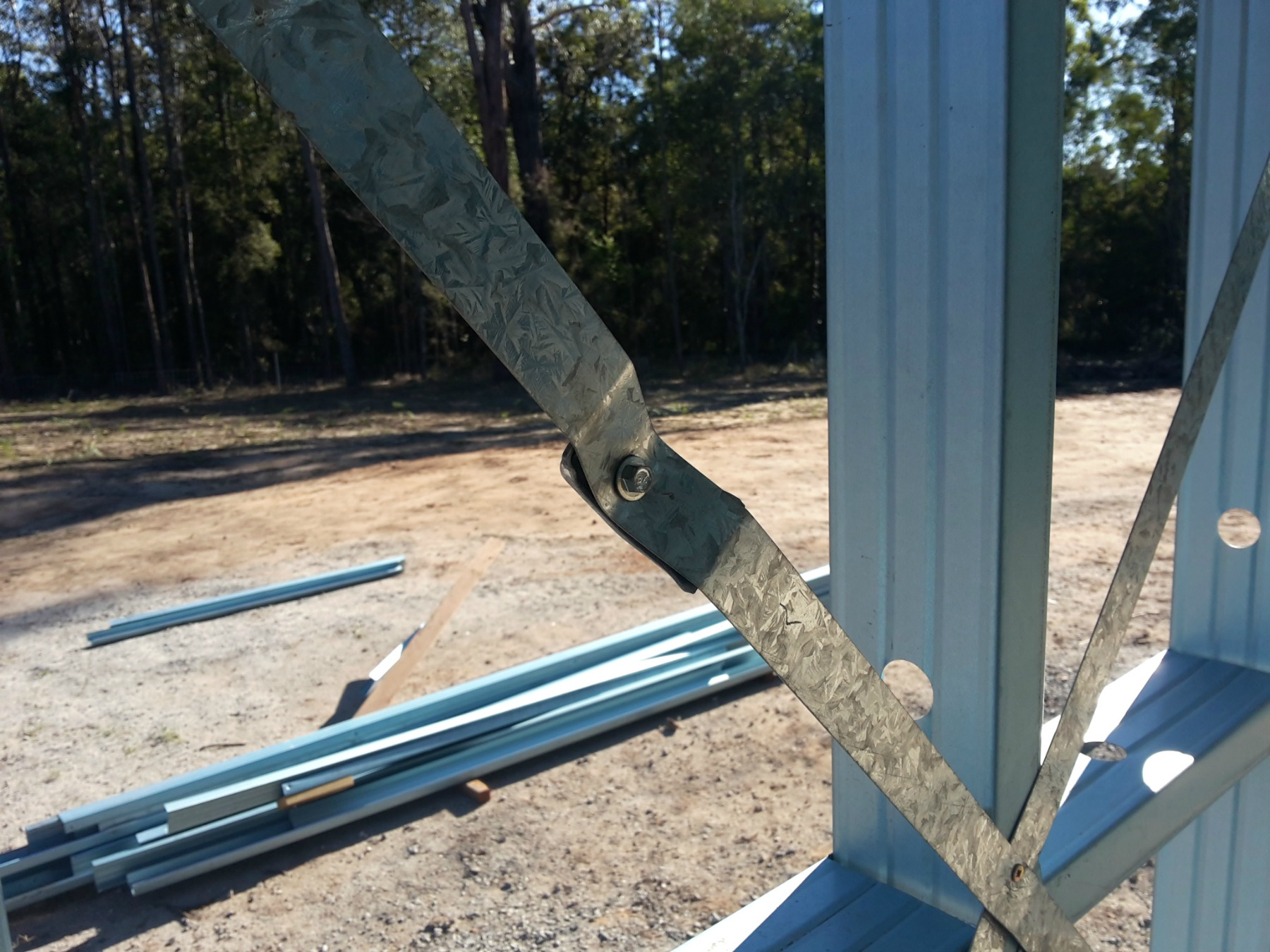 Cross brace strap tensioner