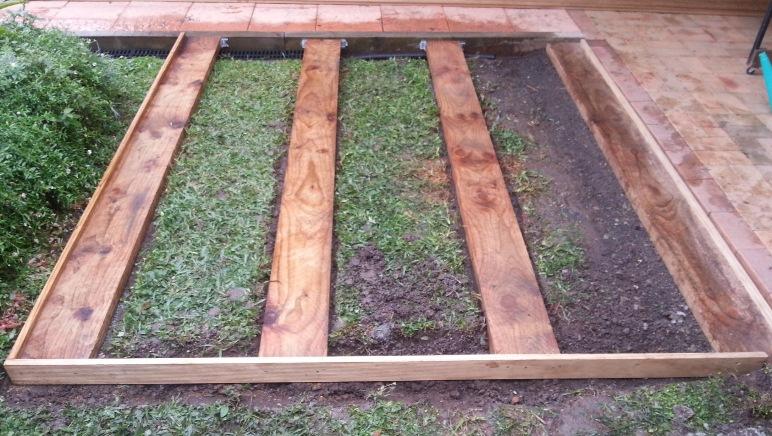 Ground level deck foundations