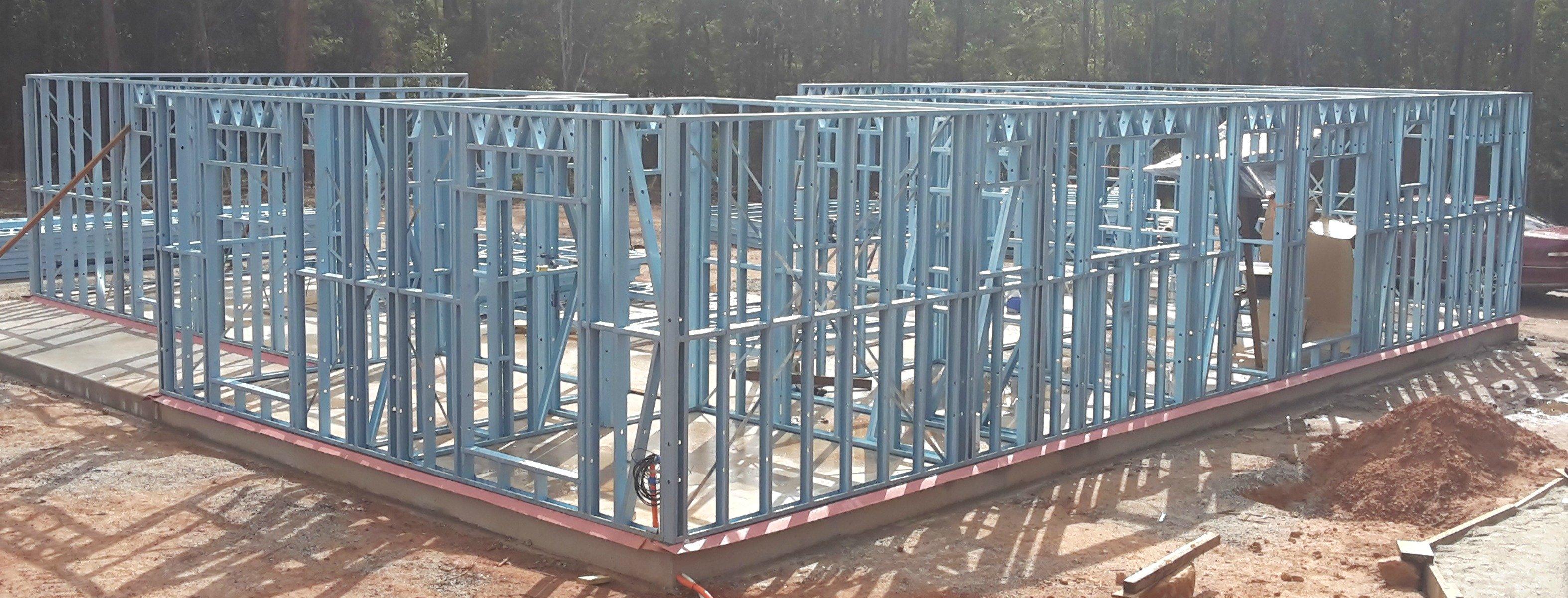 Erected steel kit home wall frames
